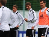 GDANSK, POLAND - JUNE 07:  Thomas Mueller (2nd R) looks on during a Germany training session at their UEFA EURO 2012 training ground on June 7, 2012 in Gdansk, Poland.  (Photo by Joern Pollex/Bongarts/Getty Images)