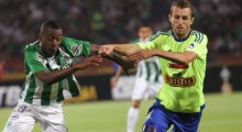 Football Soccer- Atletico Nacional v Sporting Cristal- Copa Libertadores - Atanasio Girardot stadium, Medellin, Colombia 1/3/16. Sporting Cristal's Horacio Calcaterra (R) battles for the ball with Marlos Moreno of Atletico Nacional. REUTERS/Fredy Builes